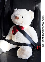 fasten your seat belt concept with teddy bear showing car ...