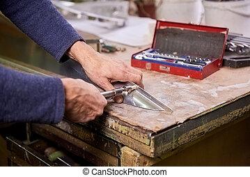 Fastener screwing. Worker is screwing a fastener using hand...