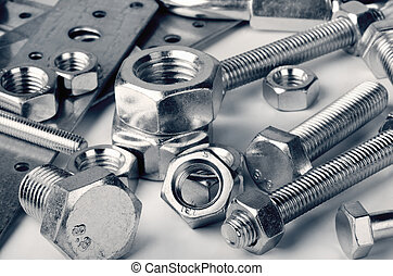 Fasteners - Close-up of various steel nuts and bolts