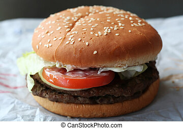 Fastfood hamburger bun on paper wrapper