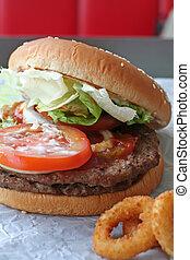 Fastfood hamburger bun on paper wrapper