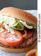 Fast food hamburger bun on paper wrapper