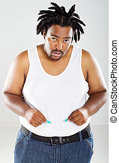 african man with measuring tape - fat african man with...