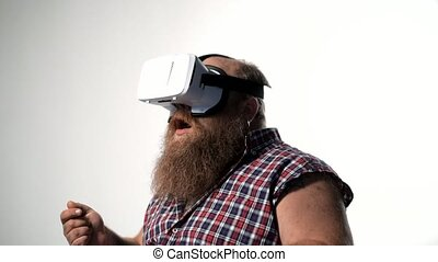 Fat bearded guy watching virtual reality device