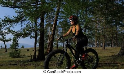 Fat bike also called fatbike or fat-tire bike in summer...