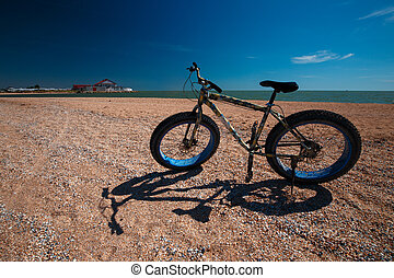 Fat Bike in the summer on the beach. Cycling and active lifestyle