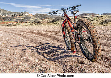 a dirty fat bike on a trail with deep, loose gravel - Big Hole Wash Trail in Red Mountain Open Space north of Fort Collins, Colorado
