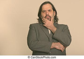 Fat Caucasian businessman thinking