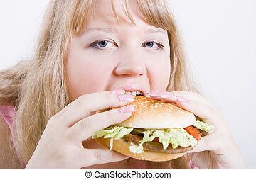fat girl with a hamburger - hungry fat girl bites the big...