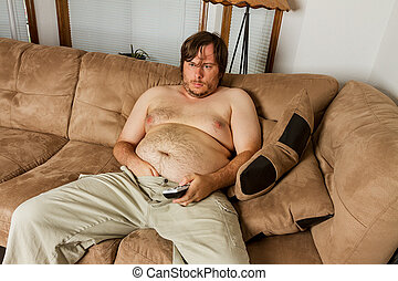 fat guy laying on the couch - Fat obese man on the couch...