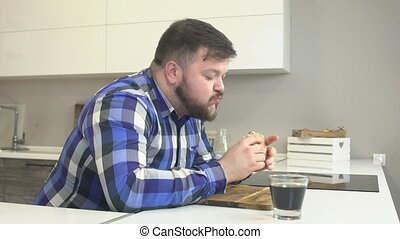 Fat man eat fat hamburger, fast food and drink a harmful...