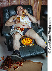 Fat man eating and watching television - Photo of a fat...