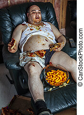 Fat man eating junk food and watching television
