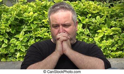 Fat Man Praying Or Thinking