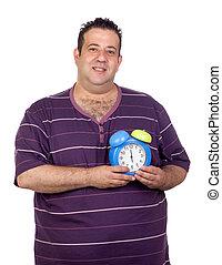 Fat man with a blue alarm clock