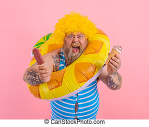 Man with beard and wig eats a popsicle and an icecream