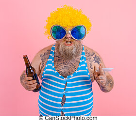 Man with beard and wig smokes cigarettes and drinks beer