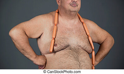 Fat man with sausages round his neck, poor quality nutrition, obesity problem