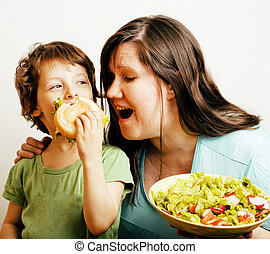 fat woman holding salad and little cute boy with hamburger...