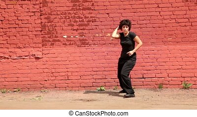 Fat woman in black clothing dance in modern style