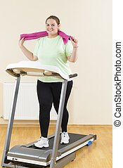 Fat Woman Running Treadmill - Confident corpulent woman...