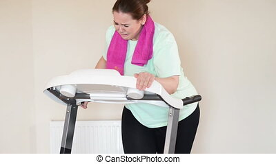Fat woman running treadmill - Corpulent woman running with...