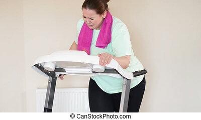 Fat woman running treadmill - Corpulent woman running with...