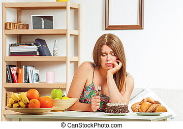 Fat woman sitting at table home