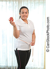 Fat woman with apple