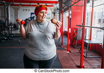 Fat woman with fast food and dumbbell, motivation