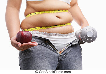 fat woman with unzup jeans holding apple and weight on each hand, id a concept to fight against obesity