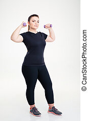 Fat woman workout with dumbbells - Full length portrait of a...