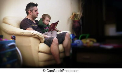 Father and Baby Boy Reading Stories