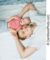 father and baby in bed