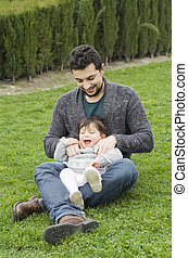 Father and baby in garden
