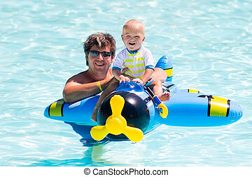 Father and baby in swimming pool