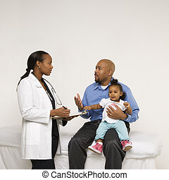 Father and baby with doctor. - African-American father...