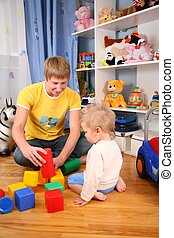 father and child in playroom