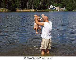 Father and child in water