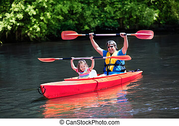 Father and child kayaking in summer - Family on kayaks and ...