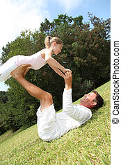 Father and child playing in park