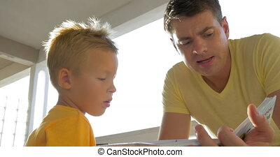 Father and child spending leisure with book