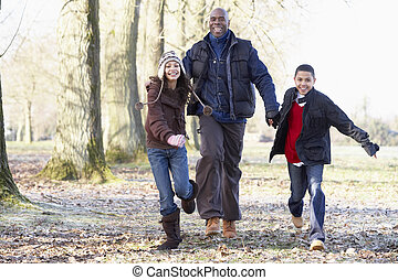 Father And Children On Autumn Walk