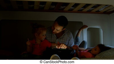 Father and children using digital tablet in bedroom at home 4k
