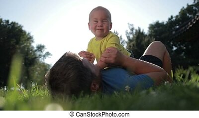 Father and cute toddler son bonding in nature
