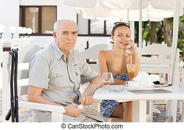 Father and daughter enjoying refreshments