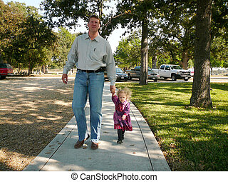 Father and Daughter - Father walking with his little girl