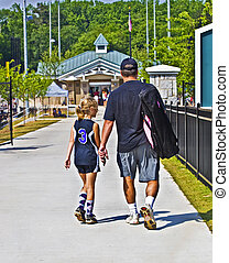 Father and Daughter Going to Softball Game