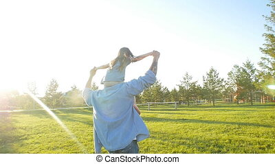 Father and daughter having fun and playing. Happy family concept