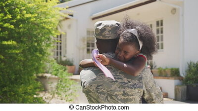 Father and daughter hugging each other - Rear view of an ...